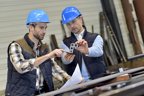 Engineer with mechanical worker checking on production-1