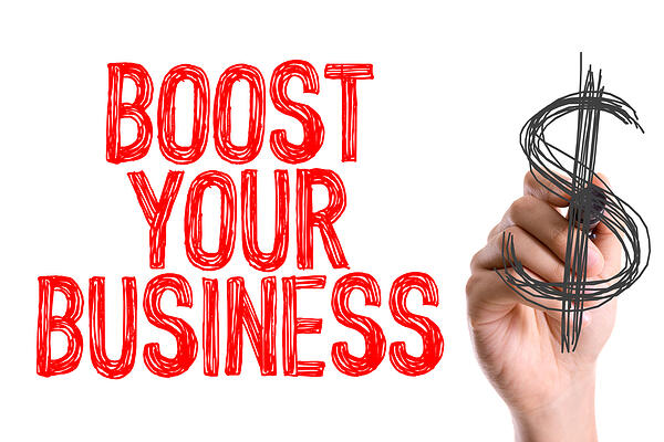 Hand with marker writing Boost Your Business