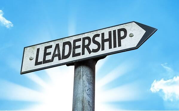 Leadership sign with sky background