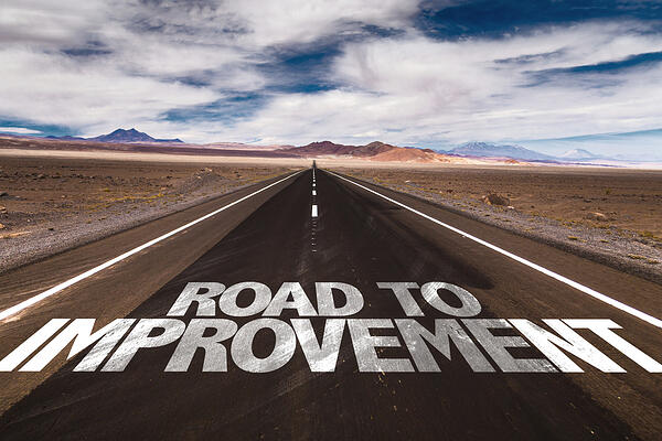 Road to Improvement written on desert road-2